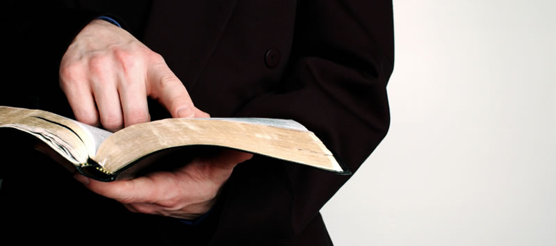 pointing at a bible